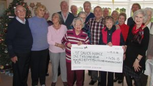 Residents with fundraising cheque at Penryhn Court Llandudno - housing from Retirement Housing Group member BUPA Assisted Living