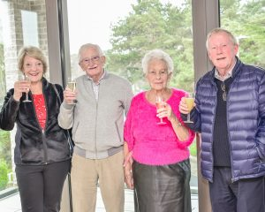 Celebrating signing up to new flat at Pegasus Life retirement scheme at Canford Cliffs, Poole, Dorset